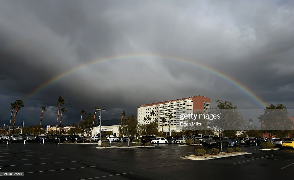 A rainbow appears over Centennial Hills Hospital Medical Center as rain, high winds some small hail and light snow flurries sweep through the area on December 11, 2015 in Las Vegas, Nevada.