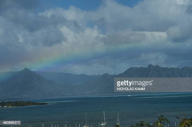 A rainbow appears over Kaneohe Bay on January 3 one day after a storm swept through the island of Oahu AFP PHOTO/NICHOLAS KAMM