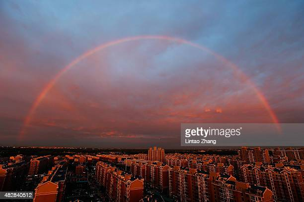 A rainbow appears over the city on August 3 2015 in Beijing China