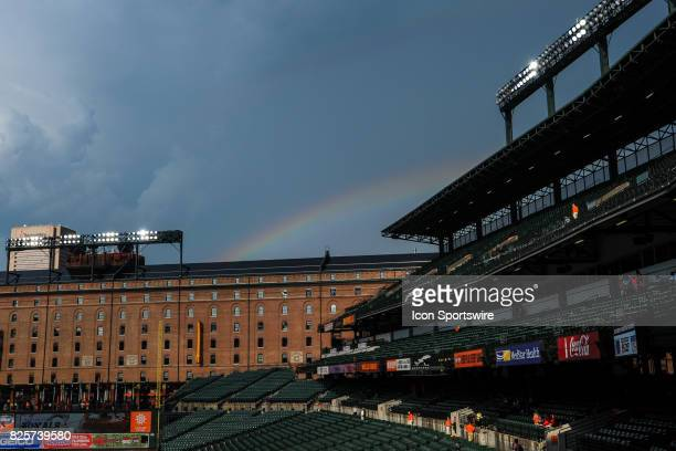 A rainbow appears over the warehouse after a rain storm prior to the MLB game between the Kansas City Royals and the Baltimore Orioles on August 2 at...