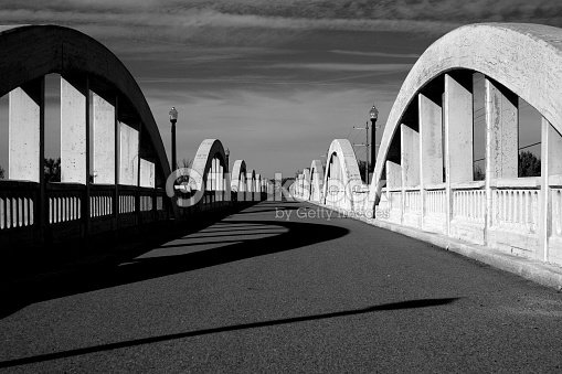 8d908f5c77ae42 Rainbow Arch Bridge over South Platte River Black and White   Stock Photo