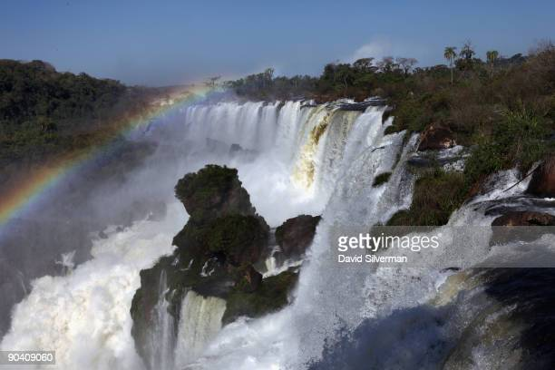 A rainbow arches over the San Martin and Mbigua cataracts of the Iguacu Falls in the Iguazu National Park on August 13 2009 near the town of Puerto...