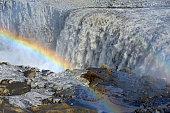 Rainbow at Dettifoss, a waterfall of the river Joekulsa a Fjoellum