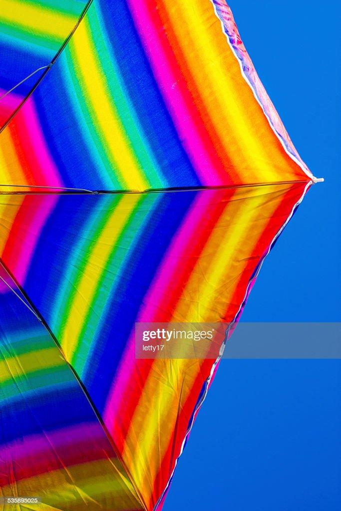 rainbow beach umbrella : Stockfoto