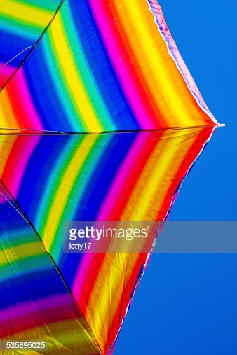 rainbow beach umbrella : Bildbanksbilder