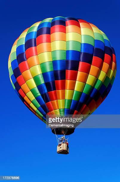 Rainbow Checkered Hot Air Balloon on a Clear Blue Sky