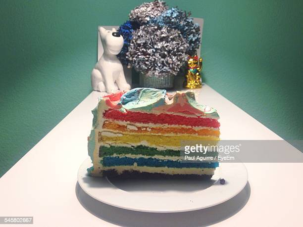 Rainbow Colored Cake Served On Table