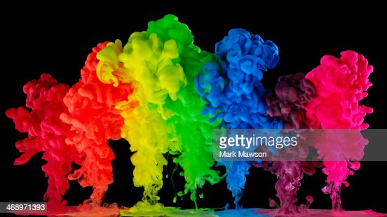 Rainbow colored ink, paint in water : Stock Photo