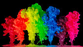 Rainbow colored ink, paint in water