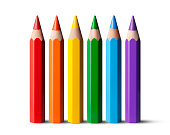 Rainbow colored pencils on white background.