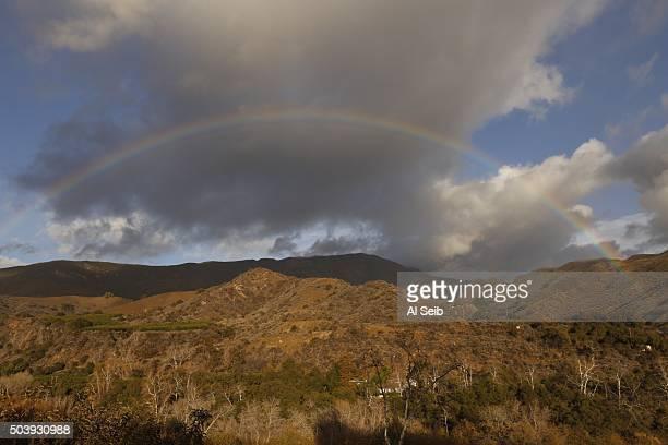 A rainbow fills the sky in the Topatopa Mountains near Santa Paula Thursday afternoon January 07 2016 as the latest El Nino storm moves through...