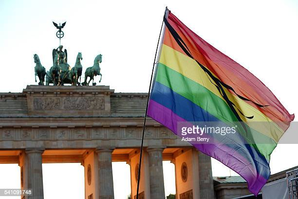 A rainbow flag flies during a vigil for victims of a shooting at a gay nightclub in Orlando Florida nearly a week earlier in front of the Brandenburg...