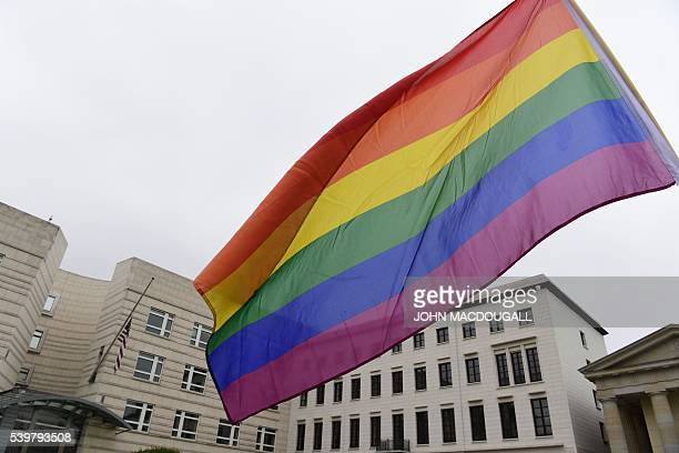 A rainbow flag is displayed in front of the US Embassy in Berlin on June 13 2016 as people pay tribute to the victims of the Orlando killin Fifty...