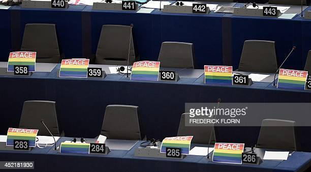 Rainbow flags with the word 'Peace' are placed at Members of the European Parliament seats on July 15 in the European Parliament in Strasbourg...