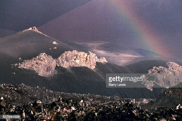 A rainbow formed after an equatorial shower over the empty lava fields 27th May 1997 on Ascension a small isolated volcanic island in the equatorial...