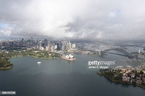 A rainbow forms across Sydney Harbour as stormy weather arrives on September 19 2015 in Sydney Australia