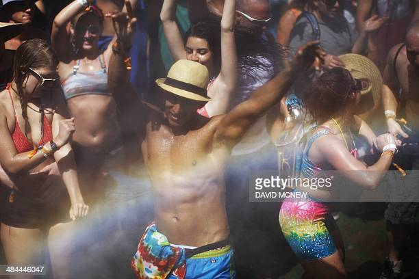 A rainbow forms as dance under spraying water at Do LaB at the Coachella Valley Music Arts Festival at the Empire Polo Club in Indio California April...