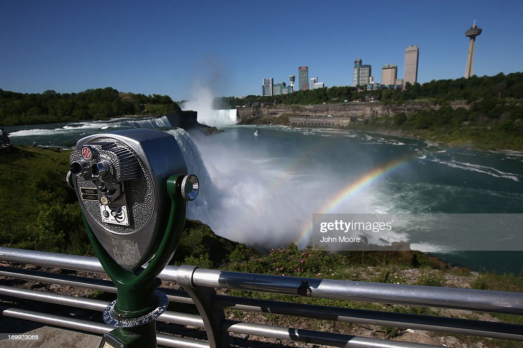 A rainbow forms in the mist of Niagara Falls on June 4, 2013 in Niagara Falls, New York. The major tourist attraction, which falls directly on the U.S.-Canada border, is a major destination for international visitors. Border Patrol agents detain travelers who have overstayed their visas as well as undocumented immigrants who attempt to illegally cross the international bridge in Niagara Falls.