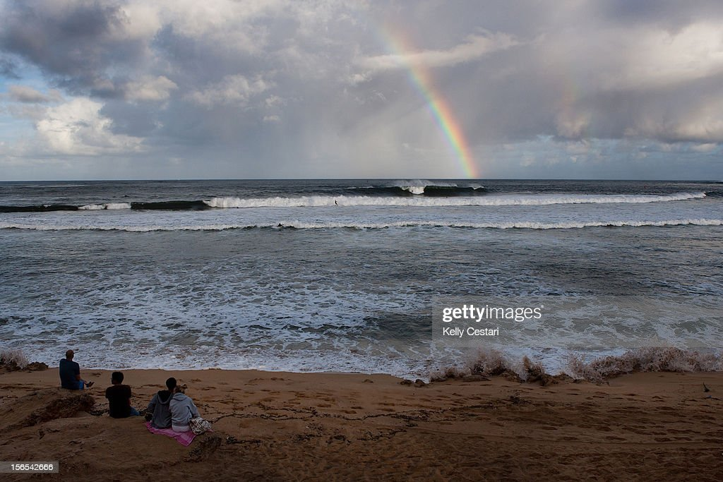 A rainbow forms over the Ali'i Beach Park lineup as Day 2 of the REEF Hawaiian Pro gets underway on the morning of November 16, 2012 in Haleiwa, Hawaii.