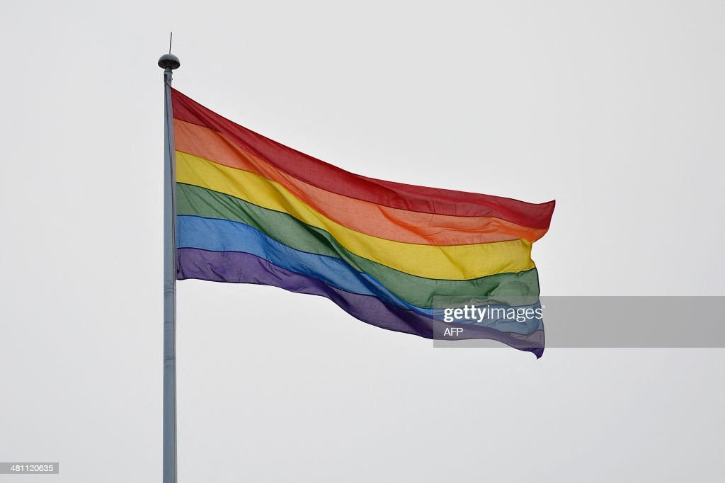 A rainbow gay pride flag flies on Whitehall in central London on March 28 2014 The countdown drew closer on March 28 to the moment at midnight when...
