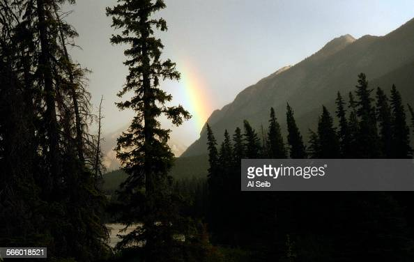 A rainbow greets the Rocky Mountaineer train as it approaches Banff after traversing through the beautiful scenery of the Canadian Rockies on July 2...