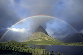 A rainbow hangs over Grinnel Point in Glacier National Park, in Montana, USA