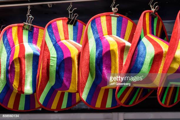 Rainbow hats for sale at a store in Calle de Alcalà