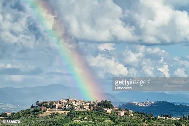 Rainbow in blue sky with dramatic clouds