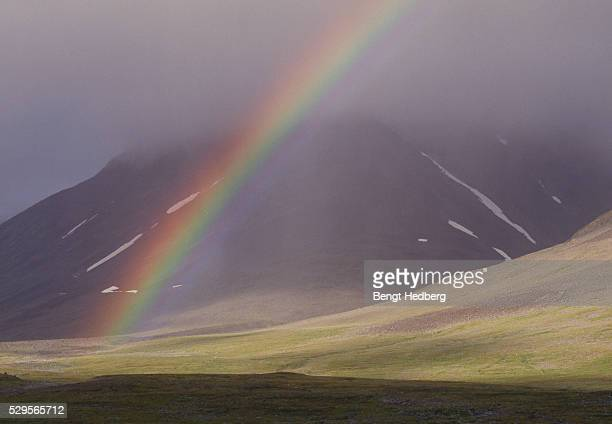 Rainbow in front of a mountain