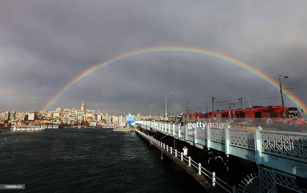 A rainbow is seen over the Galata bridge and Galata Tower after a rainy day in Istanbul on November 23, 2012.