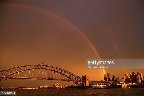 A rainbow is seen over the Sydney Harbour Bridge on June 17 2015 in Sydney Australia