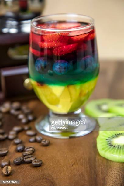 Rainbow Jello with strawberry's, blueberry and nectarine, and vintage coffee grinder homemade dessert.