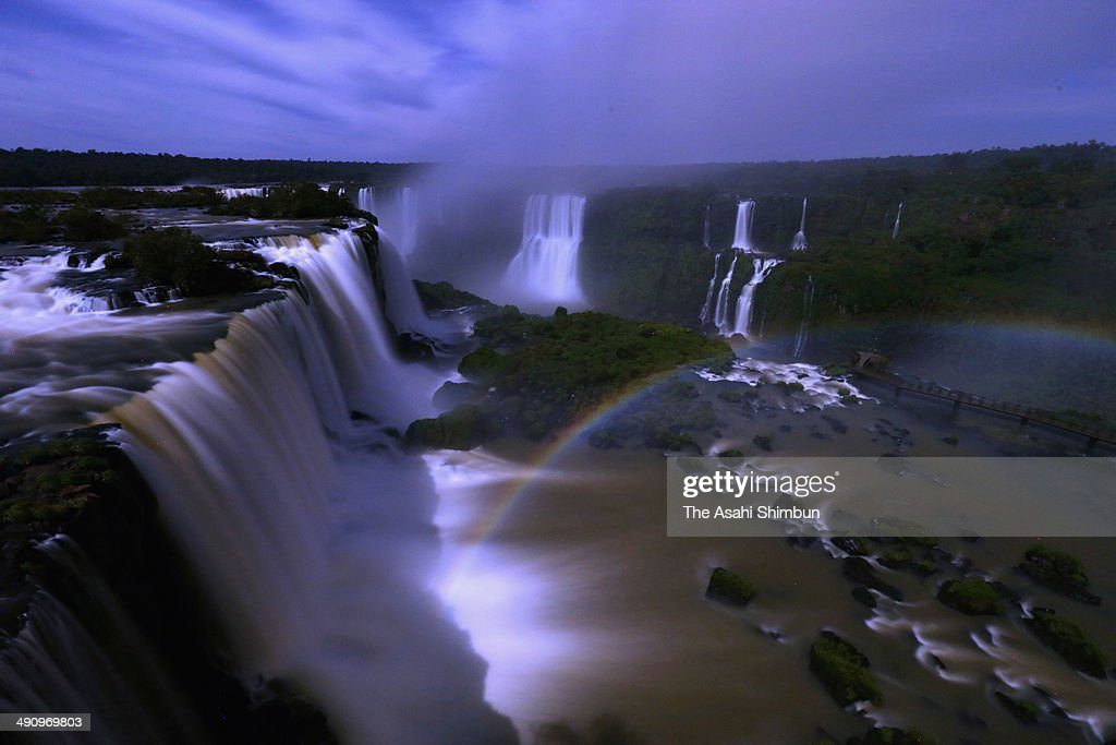 A rainbow lit by moon is seen over the Iguazu Falls on May 12, 2014 in Foz do Iguazu, Brazil.