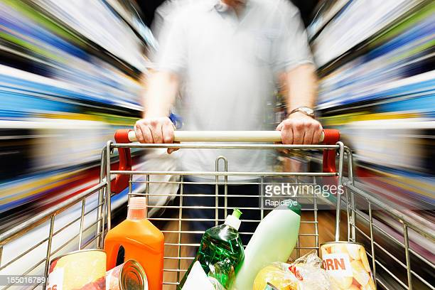 Rainbow motion blur over supermarket shelves as shopping cart passes