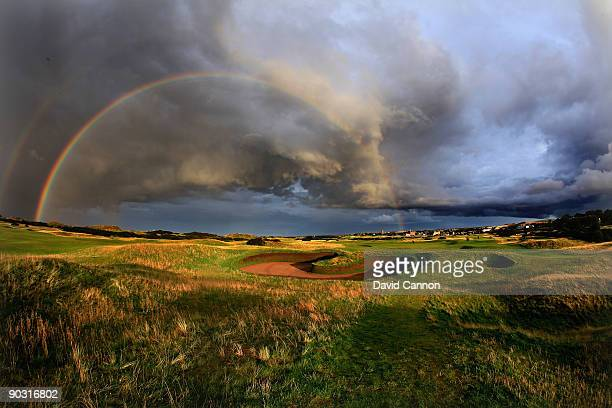A rainbow on a very stormy evening on the par 5 14th hole which shares it's green with the 4th hole is protected by the famous 'Hell Bunker' on the...