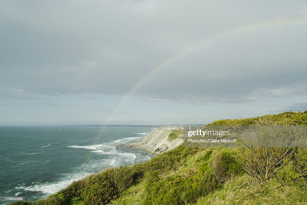 Rainbow on the cliffs of Ciboure, France : Stock Photo