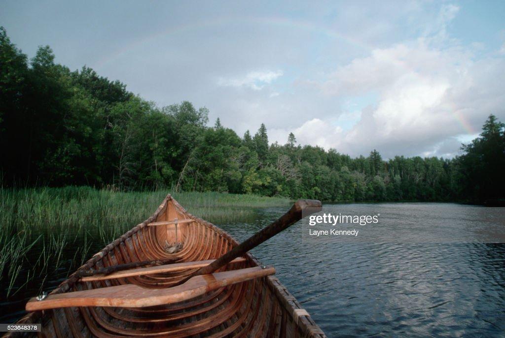 Rainbow Over Canoe on River