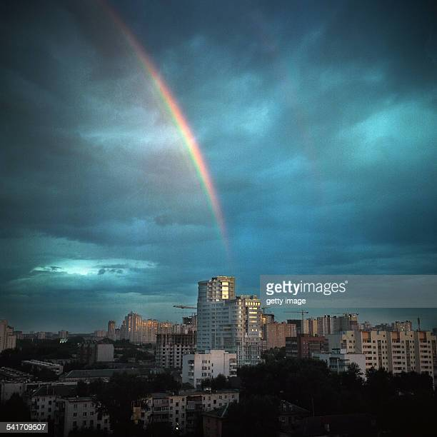 Rainbow over city