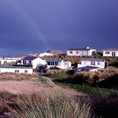 Rainbow over coastal village