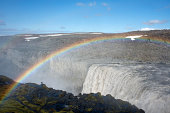 A rainbow over Dettifoss waterfall in Iceland
