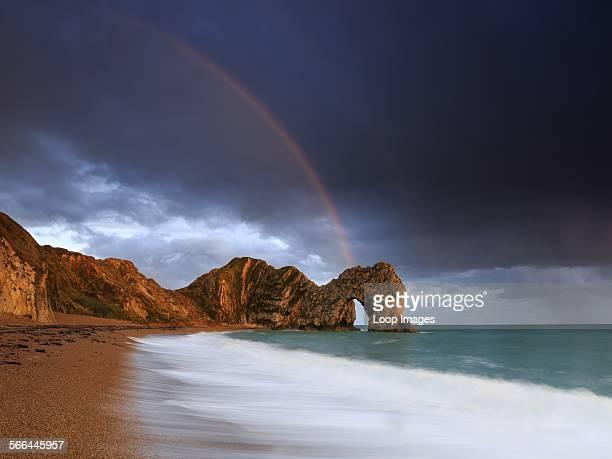 A rainbow over Durdle Door in Dorset