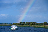 Rainbow over Le Boat Emerald Star Elegance houseboat on River Shannon.