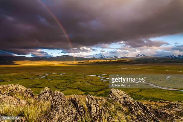 Rainbow over the mountain peaks