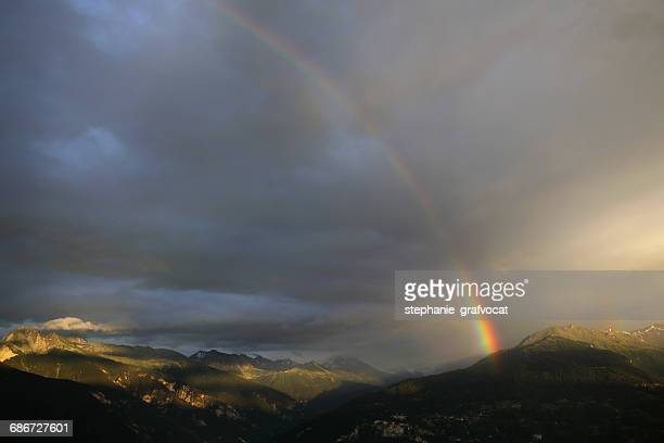Rainbow over the mountains, switzerland