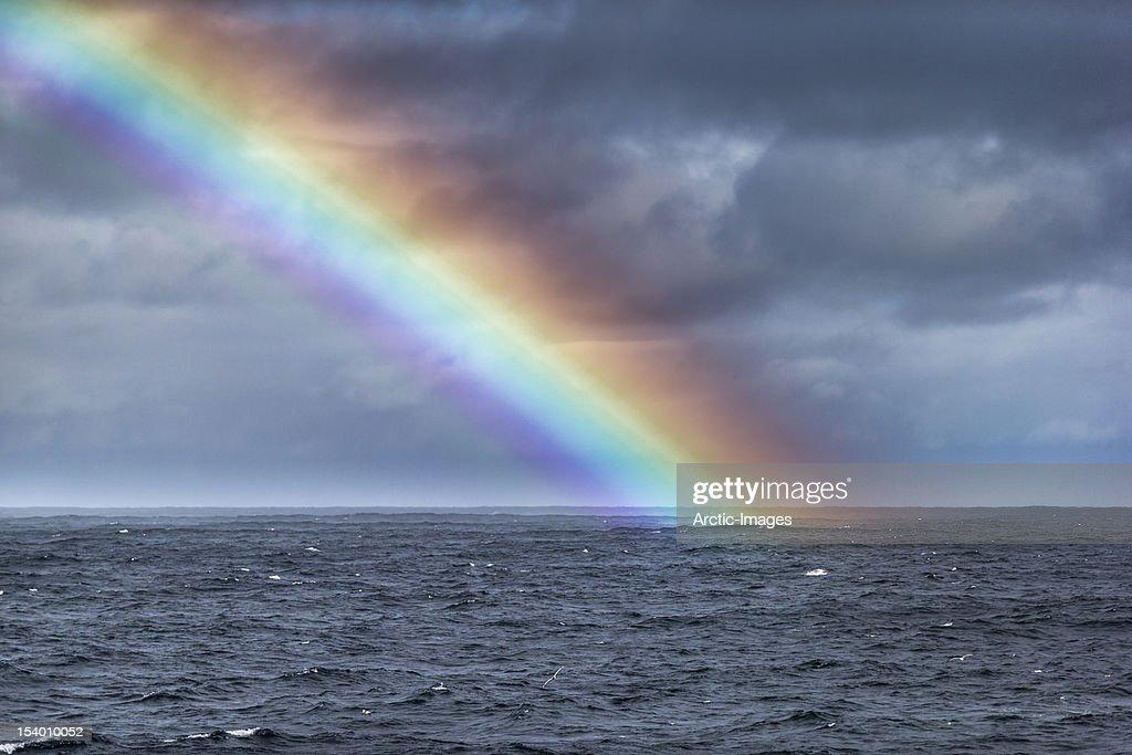 Rainbow over the ocean : Stock Photo