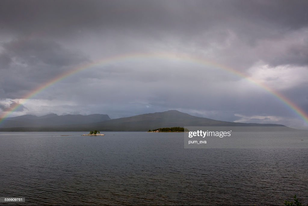 Rainbow over the sea : Stock Photo
