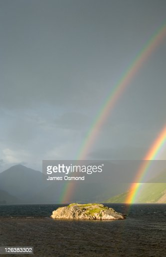 Rainbow over Wast Water with the peaks of Great Gable (left) and Lingmell (centre) in the distance Lake District National Park : Stock Photo