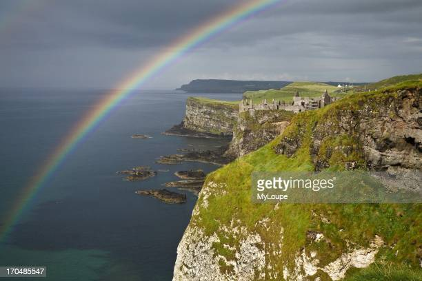 Rainbow over White Rocks and view towards Dunluce Castle North Antrim coast County Antrim Northern Ireland United Kingdom