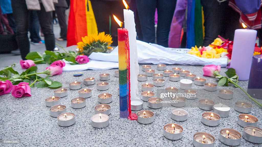 Rainbow pride candle and flowers : Stock Photo
