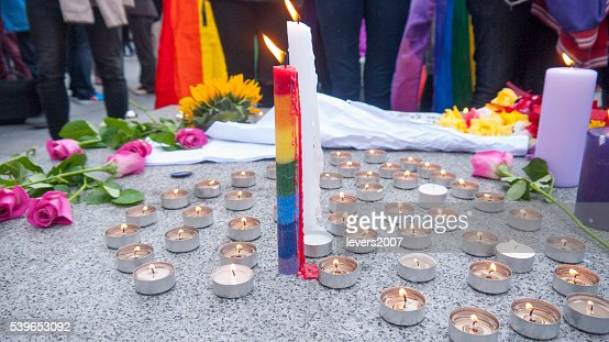 Rainbow pride candle and flowers